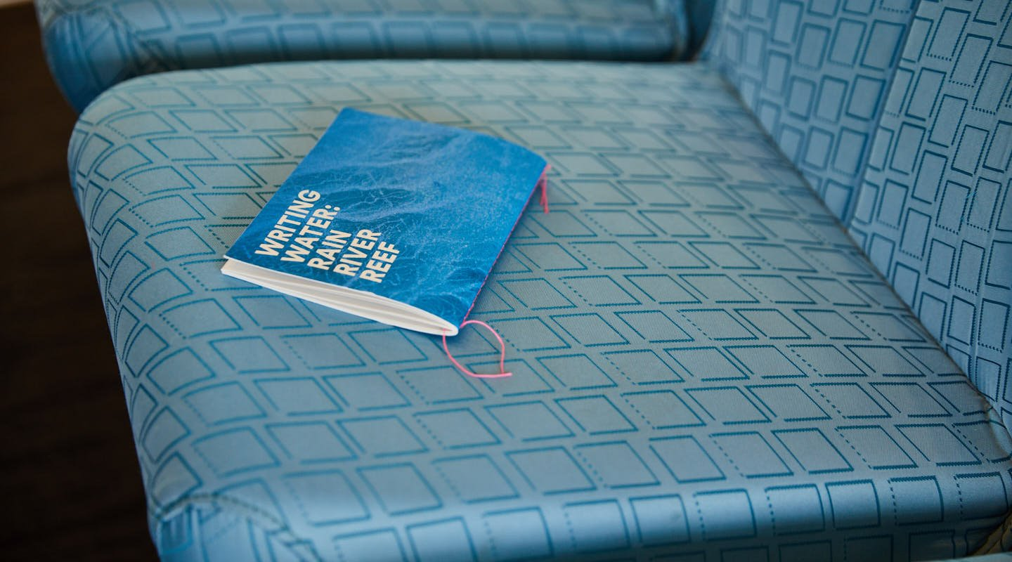 Writing Water-Sydney Ferry-chapbook on seat-Red Room Poetry.jpg